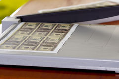 Man using manual paper cutter. Manufacture work, counterfeit money Stock Photography