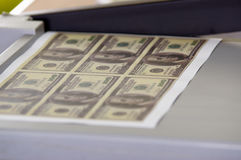 Man using manual paper cutter. Manufacture work, counterfeit money Royalty Free Stock Photo