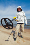 Man using a metal detector Stock Photos