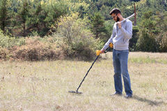 Man using a metal detector. On lawn royalty free stock photography