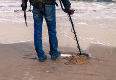 Man using a metal detector to search for metal Stock Image