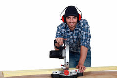 Man using a mitre saw Royalty Free Stock Photography