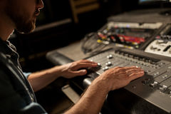 Man using mixing console in music recording studio royalty free stock photography