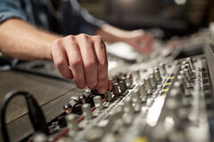 Man using mixing console in music recording studio royalty free stock photos