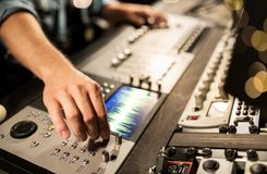 Man using mixing console in music recording studio royalty free stock image