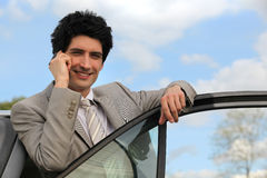 Man using mobile in his car Royalty Free Stock Images