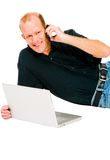 Man using mobile and laptop stock image