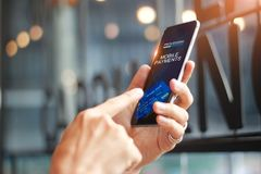 Man using mobile payments online shopping network connection Royalty Free Stock Photography