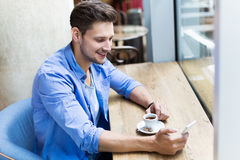 Man using mobile phone at cafe Royalty Free Stock Photos