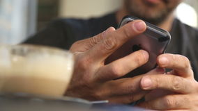 Man using mobile phone in a cafe stock video