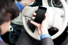 Man using mobile phone while driving Royalty Free Stock Images