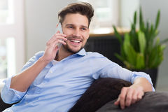 Man using mobile phone at home Royalty Free Stock Images