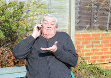Man using mobile phone and indifferent. Stock Photo