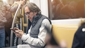 Man using mobile phone in the metro train. Man using mobile phone in the metro  train stock photos