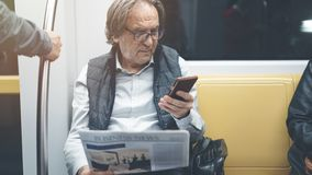 Man using mobile phone in the metro train stock photography
