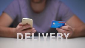 Man using mobile phone orders delivery food to house and payment by credit card. Man using mobile phone ordering delivery food to house. Order and delivery food stock video