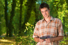 Man using mobile phone outdoors Stock Image