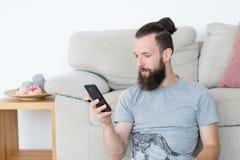 Man mobile phone reading blogging idle lifestyle. Man using mobile phone reading message or blogging. idle lifestyle and leisure stock photography