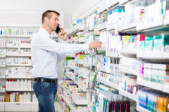 Man Using Mobile Phone While Selecting Product In Royalty Free Stock Photo