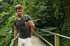 Man Using Mobile Phone, Smartphone In Nature. Travel, Tourism. Man Using Mobile Phone For Communication. Tourist Male Holding Smartphone On Summer Travel Royalty Free Stock Image