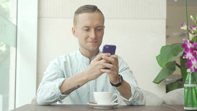 Man using mobile phone and smiling royalty free stock images