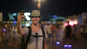 Man using a mobile phone on the street. a handsome man in a hat with smatrtfonom stock video