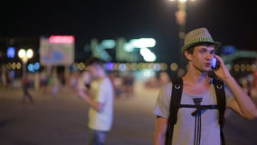 Man using a mobile phone on the street. a handsome man in a hat with smatrtfonom stock footage