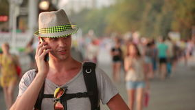 Man using a mobile phone on the street. a handsome man in a hat with smatrtfonom stock video footage