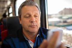 Man using mobile phone during train ride Royalty Free Stock Photo
