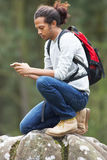 Man Using Mobile Phone Whilst Hiking In Countryside Royalty Free Stock Photo