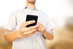Man using mobile smart phone Stock Images