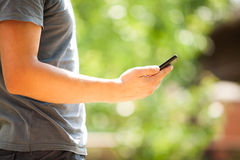 Man using mobile smart phone outdoor Stock Image