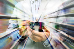 Man using mobile smart phone on super market background as Doubl Royalty Free Stock Photos