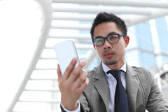Man using mobile smart phone Royalty Free Stock Photo