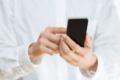 Man using a mobile smartphone Stock Images