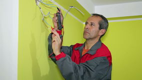 Man Using A Multimeter Stock Images