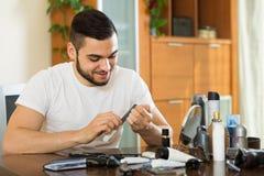 Man using nail file Stock Photography