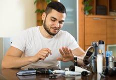 Man using nail file Stock Photos