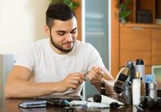 Man using nail file Stock Photo