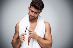 Man using a nail file Stock Photo