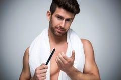 Man using a nail file Royalty Free Stock Image