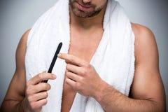 Man using a nail file royalty free stock images