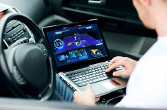Man using navigation on laptop computer in car Royalty Free Stock Images