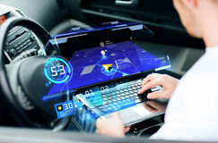 Man using navigation on laptop computer in car. Transport, modern technology and people concept - man using navigation system on laptop computer in car Royalty Free Stock Photo