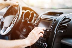 Man using navigation system while driving car stock image