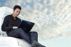Man using notebook outdoors royalty free stock image