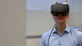 Man using oculus rift in college stock video footage