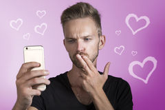 Man using online dating app. Young man giving kisses dating online Stock Photo