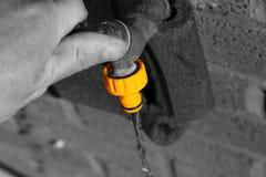 Man using outdoor water tap Royalty Free Stock Image