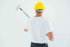 Man using paint roller Royalty Free Stock Photography